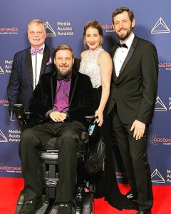 John Lawson, Tobias Forest, Kelli McNeil and Alexander Yellin smile together on the red carpet at the Media Access Awards