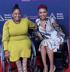 two African American women wearing dresses seated in wheelchairs