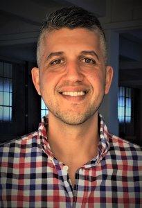 Daniel Peri smiling headshot