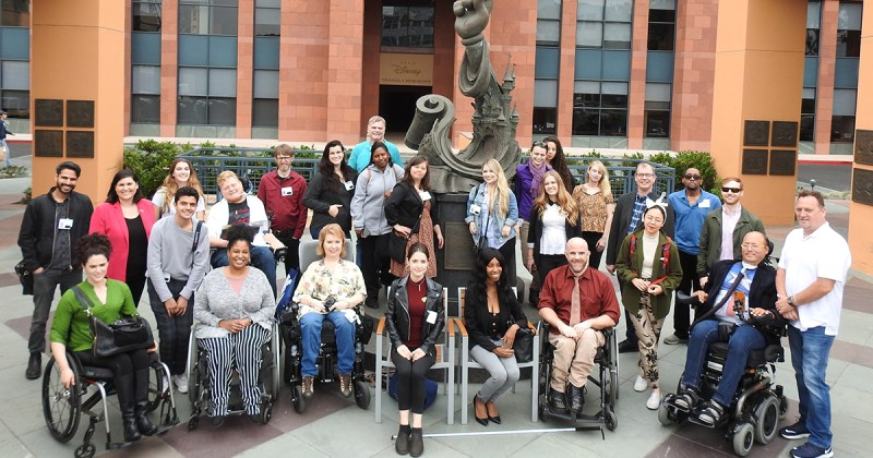 diverse group of summer lab participants with disabilities posing for photo on Walt Disney lot