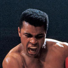 Muhammad Ali shirtless in the middle of a fight