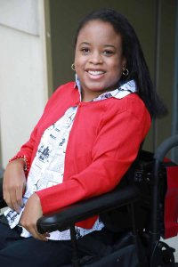 Ketrina Hazell seated in her wheelchair, smiling