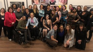 Attendees at the November 2019 launch of Women and Nonbinary Speakers Bureau: NYC at Positive Exposure smile together