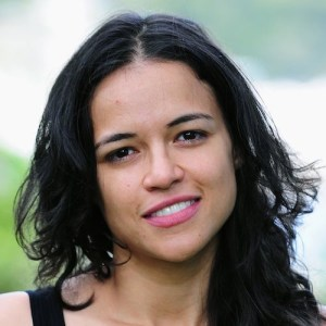 Michelle Rodriguez wearing a black tank and smiling