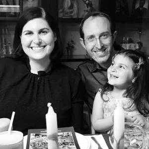 Lauren Appelbaum with her husband and daughter celebrating Passover