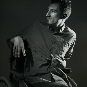 Andrew Pilkington portrait with him using a wheelchair