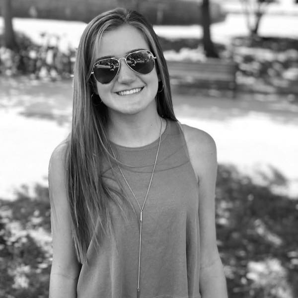 Samantha Haas smiling outside wearing sunglasses