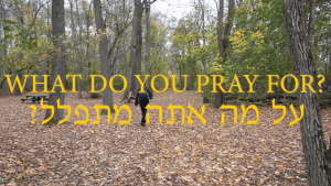 Title card for What Do You Pray For? Ben Rosloff is in the forest in the background