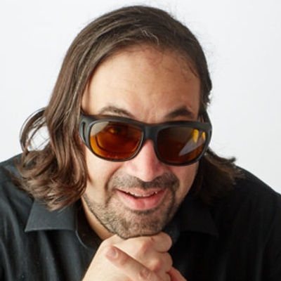 Ben Fox headshot wearing sunglasses