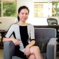 Naomi Funabashi headshot seated on a cushioned chair
