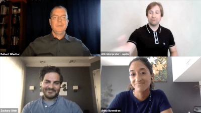 Three panelists and ASL interpreter on a zoom meeting together smiling