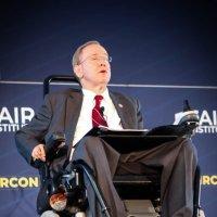 Rep Jim Langevin seated in a wheelchair speaking