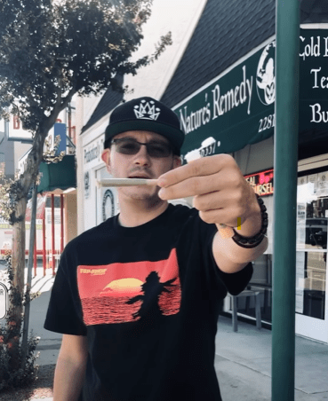 RMR Joey holding the rolled joint for observation