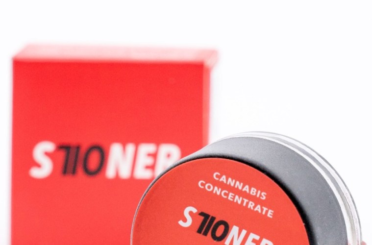 S710NER cannabis concentrate in front of packaging