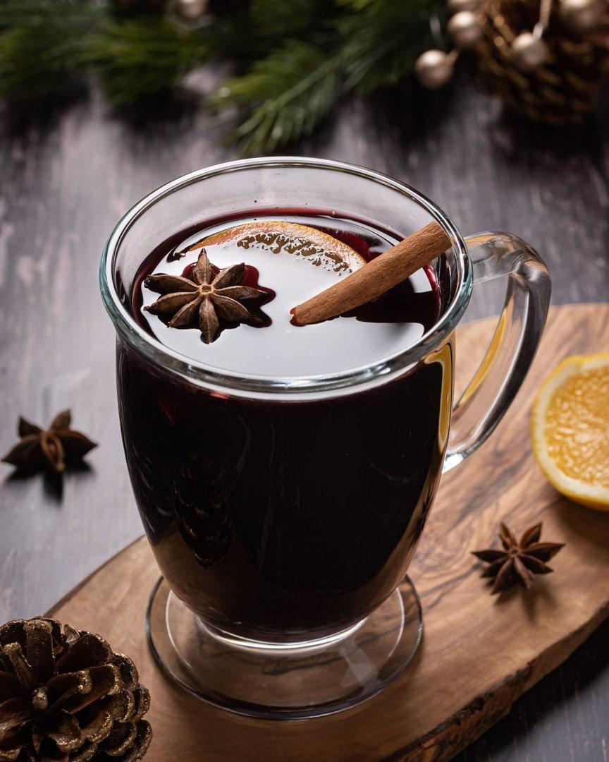 mug of mulled wine with cinnamon stick, anise, and orange slice