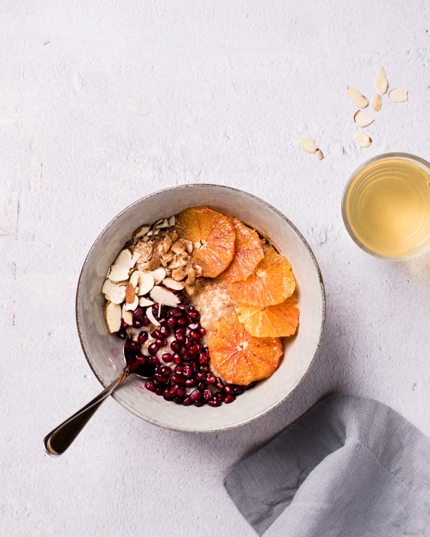 oatmeal with blood oranges, pomegranate, sliced almond and green tea