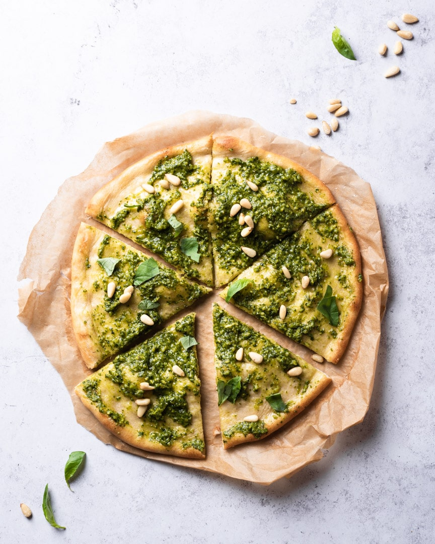 pesto pizza with pine nuts and basil