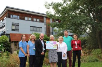 East Oxford Health Centre tenants donate funds raised at NHS 70 event to mental health charity neighbour