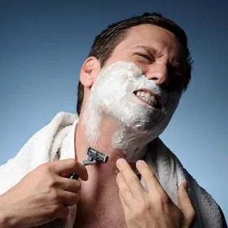 Man Shaving With Razor Burn how to get rid of shaving bumps