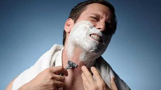 Man Shaving With Razor Burn how to get rid of shaving bumps