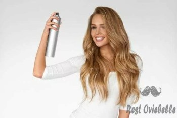 woman spraying hairspray on beautiful curly hair. hairdressing - hairspray s and pictures best hairspray for fine thin hair