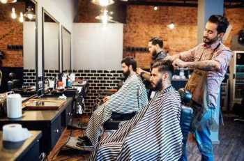 hairdressers cutting hair of clients in salon - barbers s and pictures Things To Consider When Buying Edgers For Barbers tips