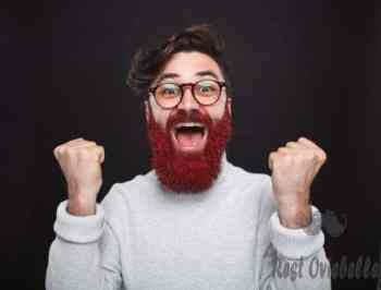 excited trendy man with glittering beard - beard dye s and pictures Things to consider when buying beard dye