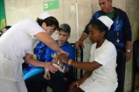 Cuban Medical Professionals attending to young cancer patient in Havana Hospital, Photo: Bill Hackwell