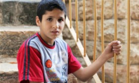 The only thing I want to do is play, play without care - the way [the settler children] do,' Saed Seider said [Abed al-Qaisi/Al Jazeera]