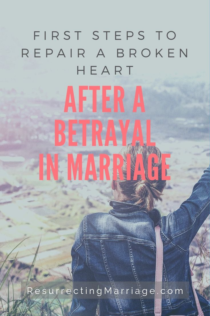 Woman raising her hand praising God as she looks off in the distance with text overlay First steps to repair a broken heart after a betrayal in marriage