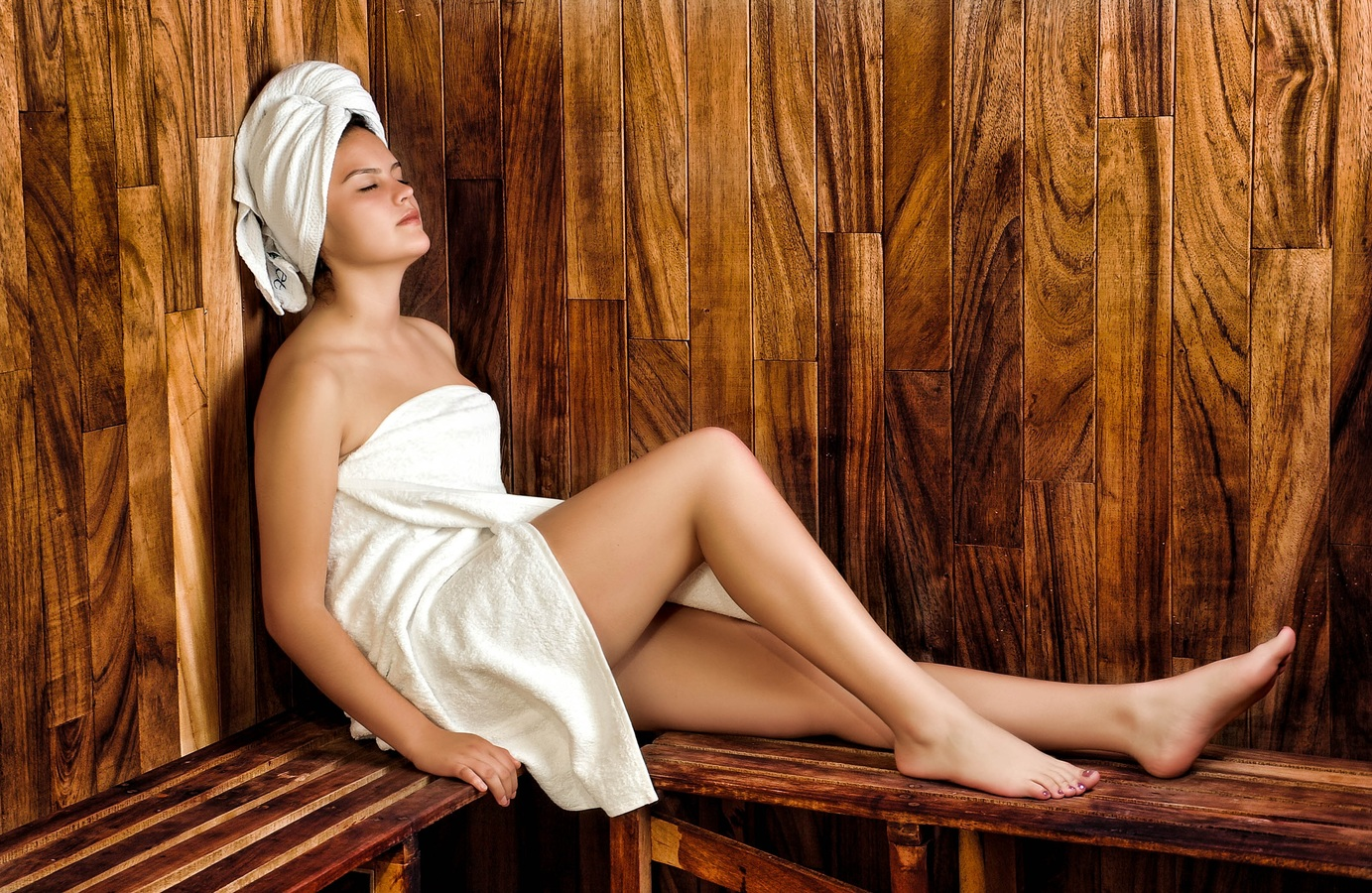 a woman in a sauna room