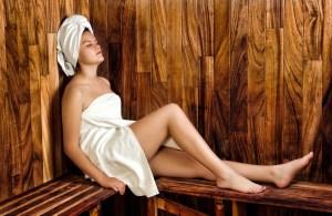 a woman in a sauna room