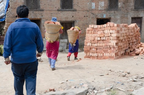 Brick-carrying in baskets
