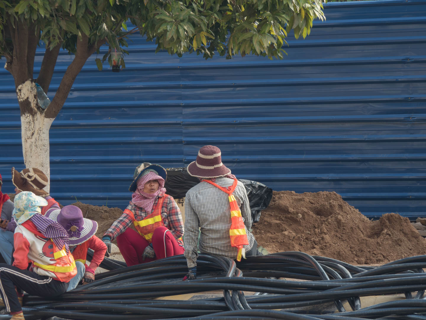 women resting from laying water line