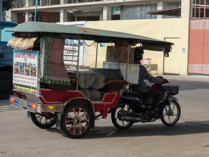 tuktuk with bags of rice