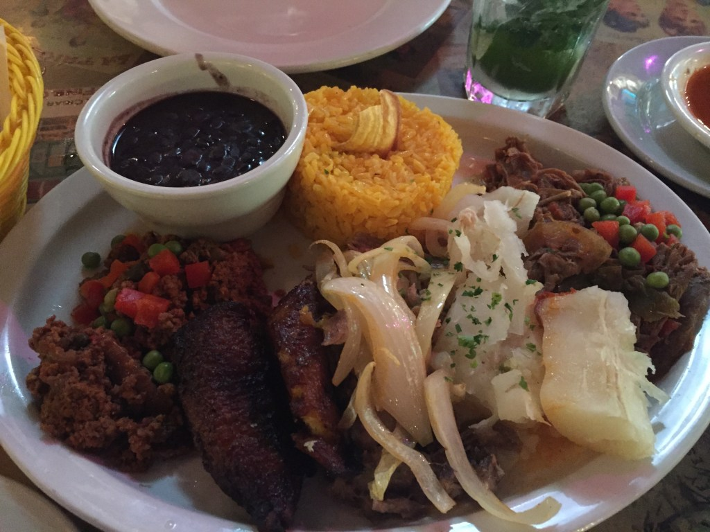 Our incredible Cuban meal: Picadillo, Lechon Asado, Ropa Vieja, and all the trimmings!