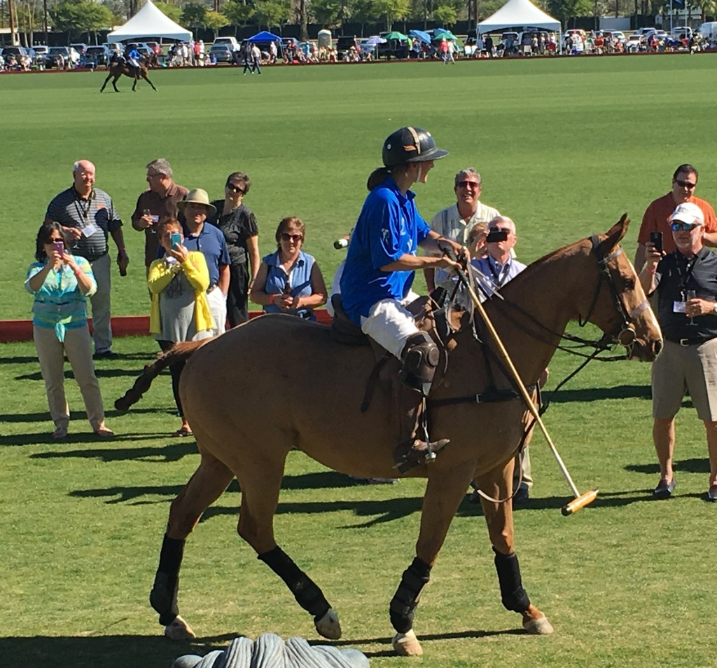 This player is demonstrating polo rules. And yes, teams consist of male and female players.
