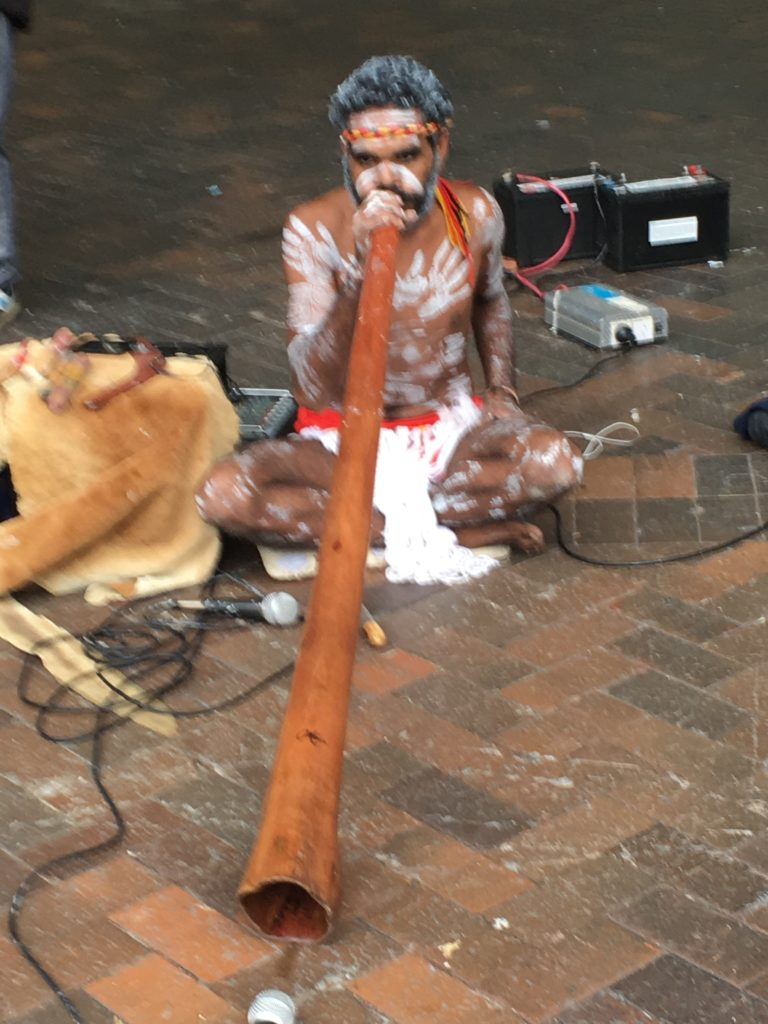 Didgeridoo Player on the Quay