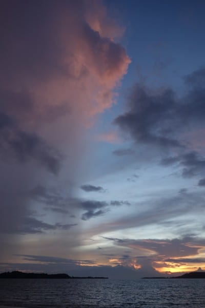 A sunrise rainstorm passes us on Gili Asahan.