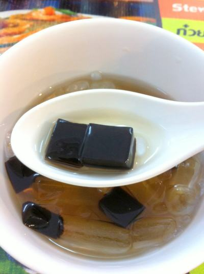 black jelly dessert in bangkok, with ice water