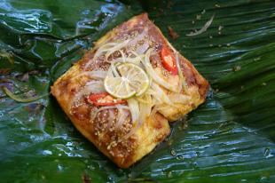 Grilled, stuffed tofu cooked in banana leaf
