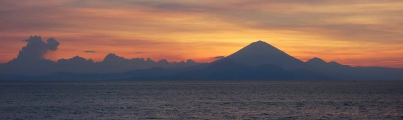 A view of Mt Agung at sunset from across the Lombok Strait