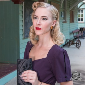 Wearing an elegant Stop Staring! Faith dress in deep eggplant at the vintage train station, Annie Fawn appeared in our first edition fashion feature.