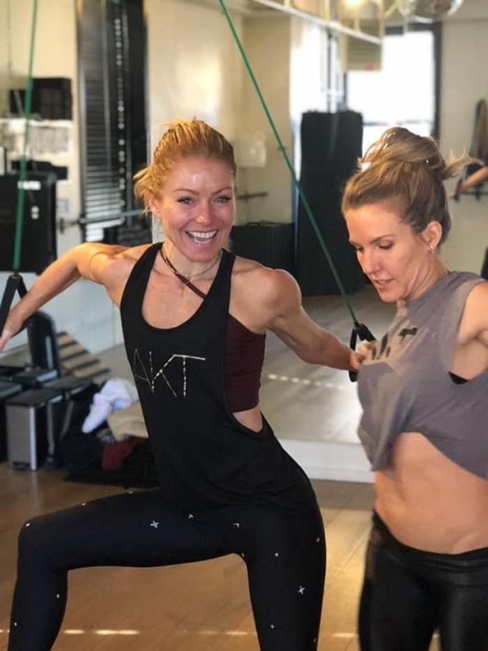 kelly ripa and friend working out