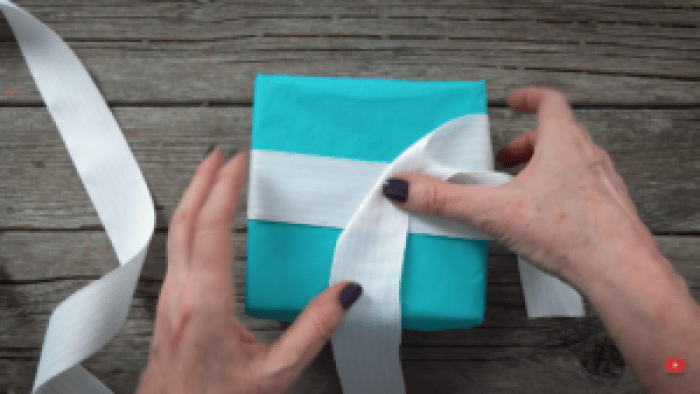 One ribbon that's the right length can create that fancy criss-crossed ribbon to finish a gift off