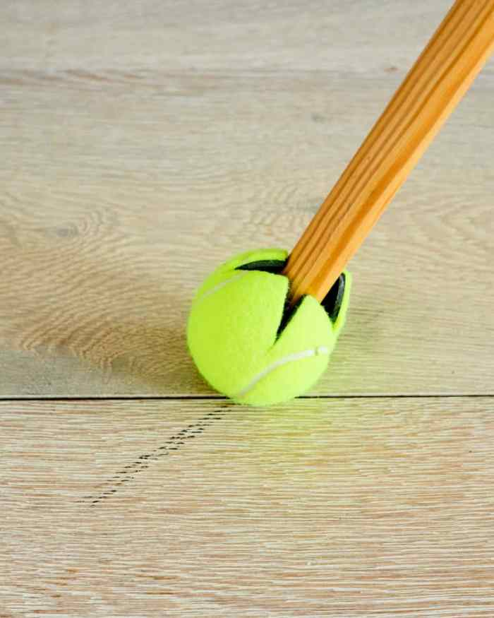 how to use a tennis ball to get rid of scuff marks