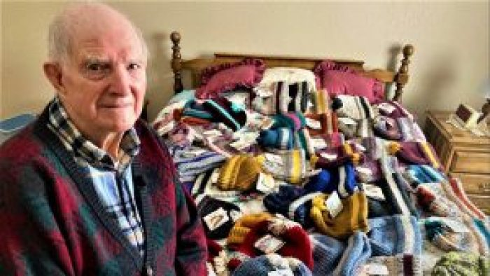 Tom Cornish and hits knitted wool hats