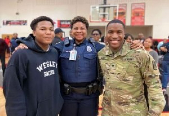 Aquil surprised both his mother (center) and younger brother Justin (left) with his early return