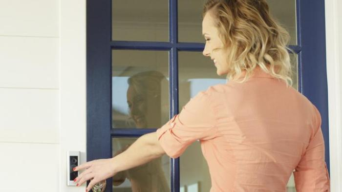woman ringing a doorbell