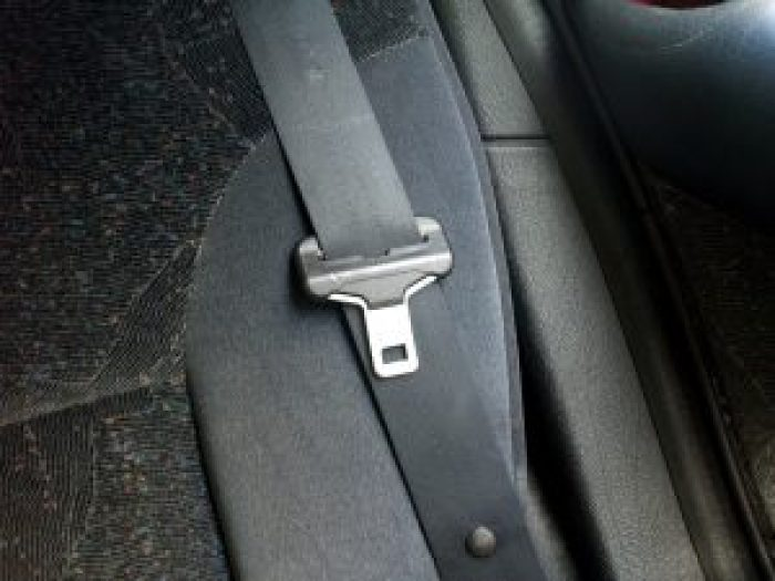 Making seat belts required had manufacturers reshape the way they did things